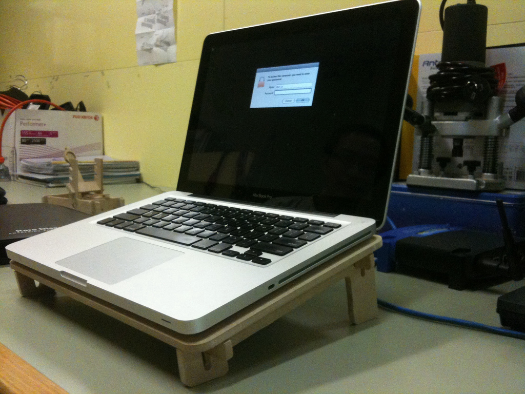 Laptop on a stand on top of a desk