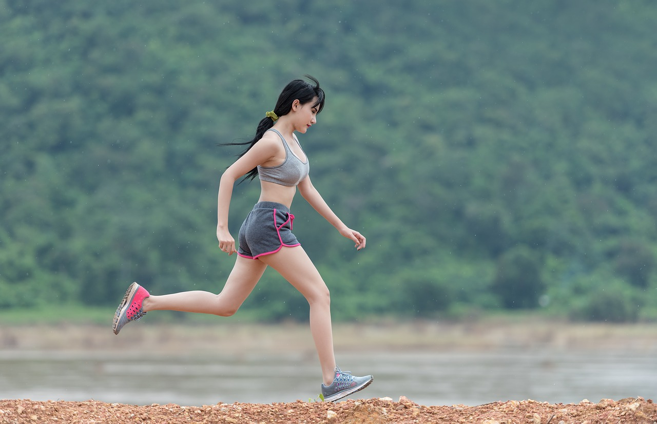 Woman with running shoes running