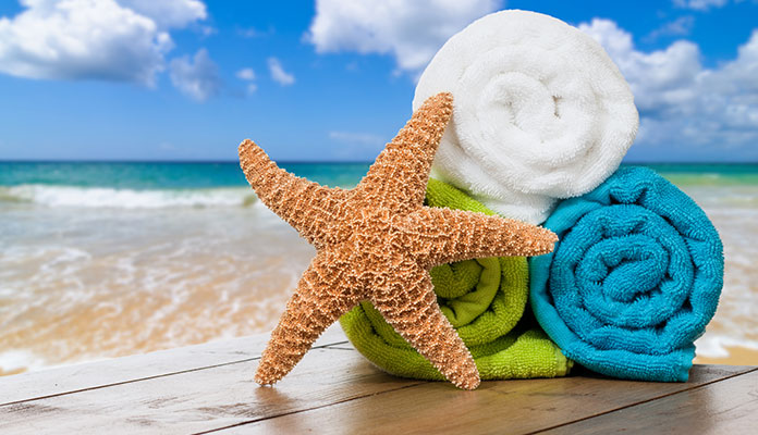 Starfish with bunch of towels near a beach