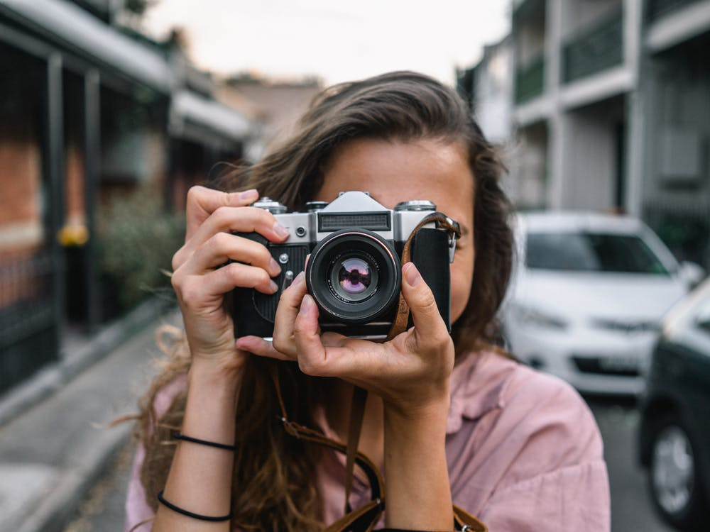 https://www.pexels.com/photo/woman-using-slr-camera-2179205/
